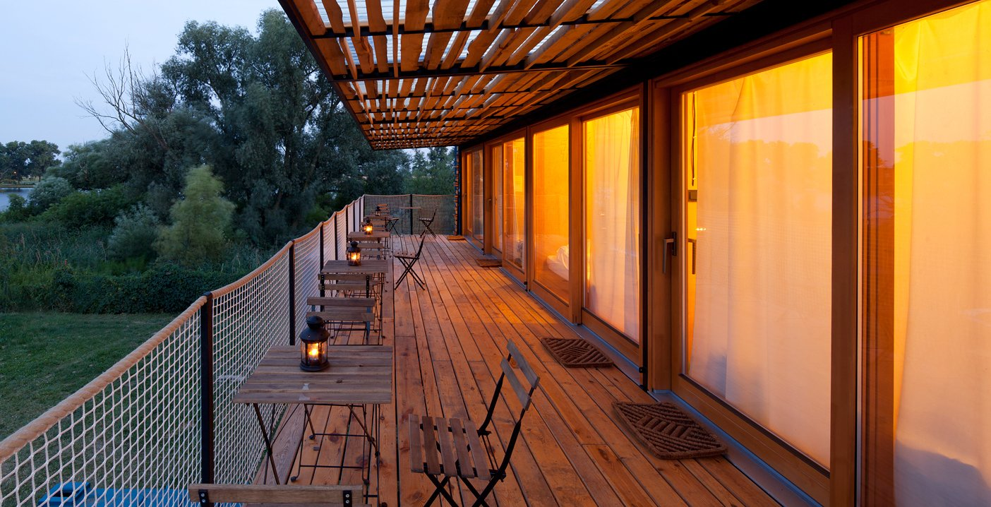 Rooftop, Trees, Wood Patio, Porch, Deck, and Exterior  Photo 13 of 15 in A Mobile Boutique Hotel For the Modern Traveler Made From Shipping Containers