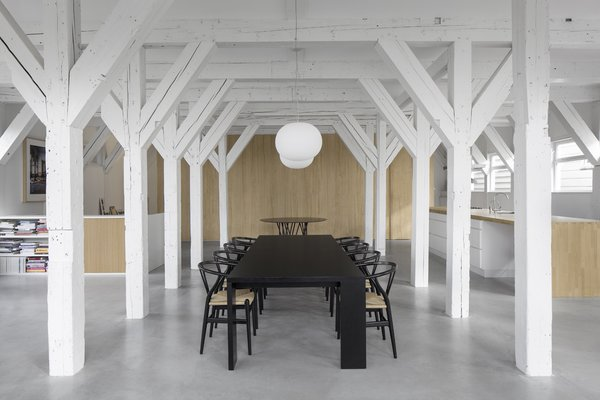 A Converted Warehouse in Amsterdam Boasts Soothing Interiors of Concrete and Wood