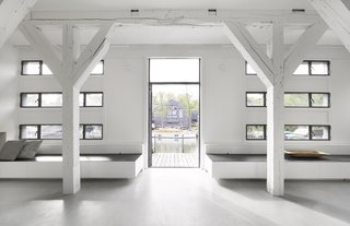 Existing, renovated windows provide ample daylight and views of the surrounding shipyard.
