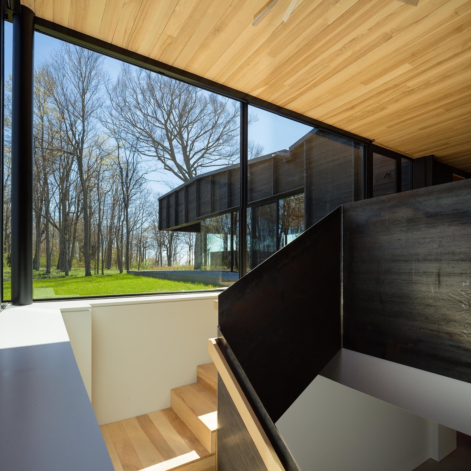 Staircase, Wood Tread, and Metal Railing  Photo 9 of 12 in A Dramatic Cantilevered Roof Creates a Spacious Terrace Overlooking Lake Michigan