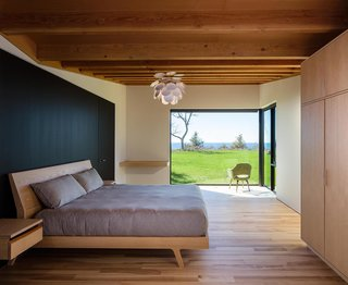 The master suite has a large corner window that creates a private, interior terrace for enjoying the natural landscape.