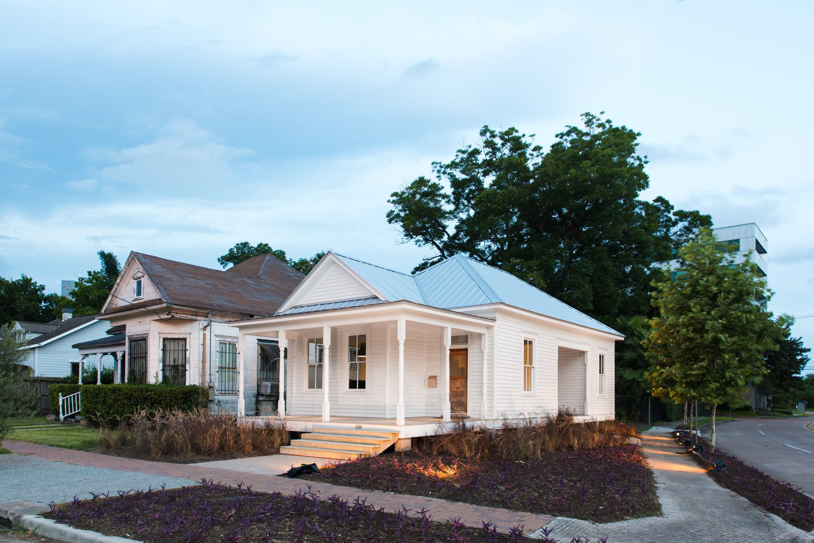 Exterior, Metal Roof Material, House Building Type, Hipped RoofLine, and Wood Siding Material  Photo 1 of 14 in A Victorian Cottage in Houston Finds New Life as a Local Firm's Office