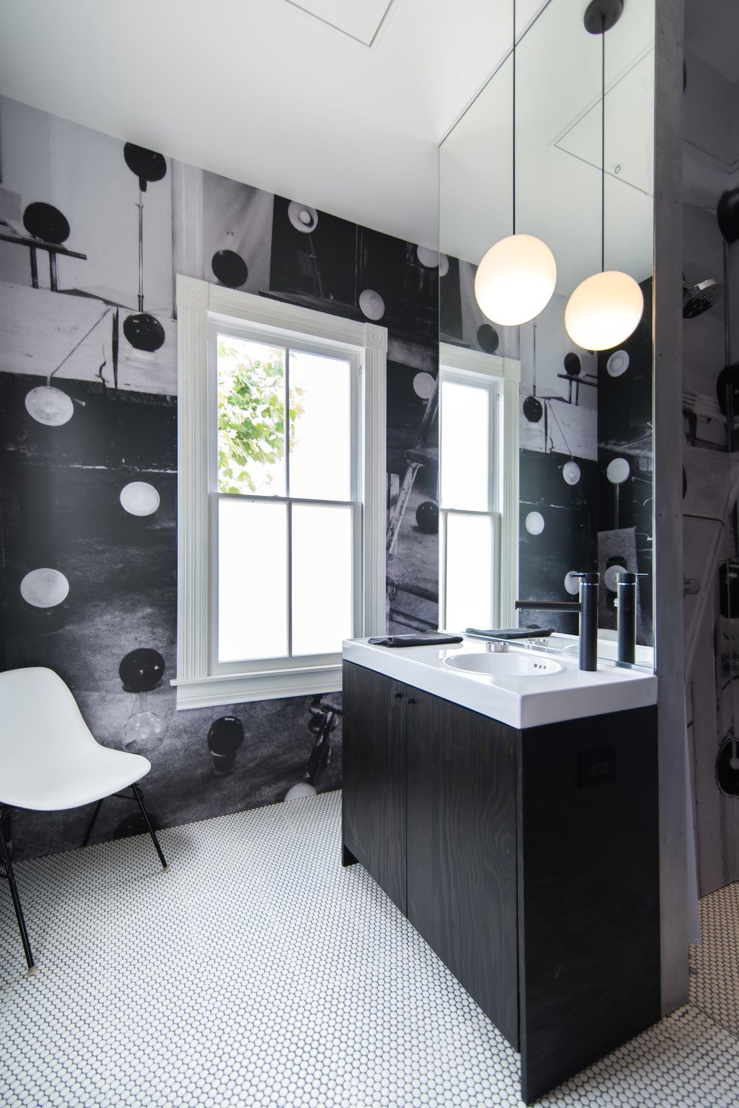 Bath Room, Ceramic Tile Floor, Accent Lighting, and Pendant Lighting  Photo 13 of 14 in A Victorian Cottage in Houston Finds New Life as a Local Firm's Office