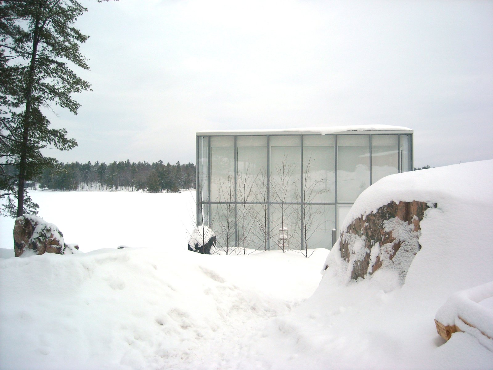 Exterior, House Building Type, Glass Siding Material, and Flat RoofLine  winter from This Mesmerizing Glass House Is Also a Photographer's Lakeside Studio