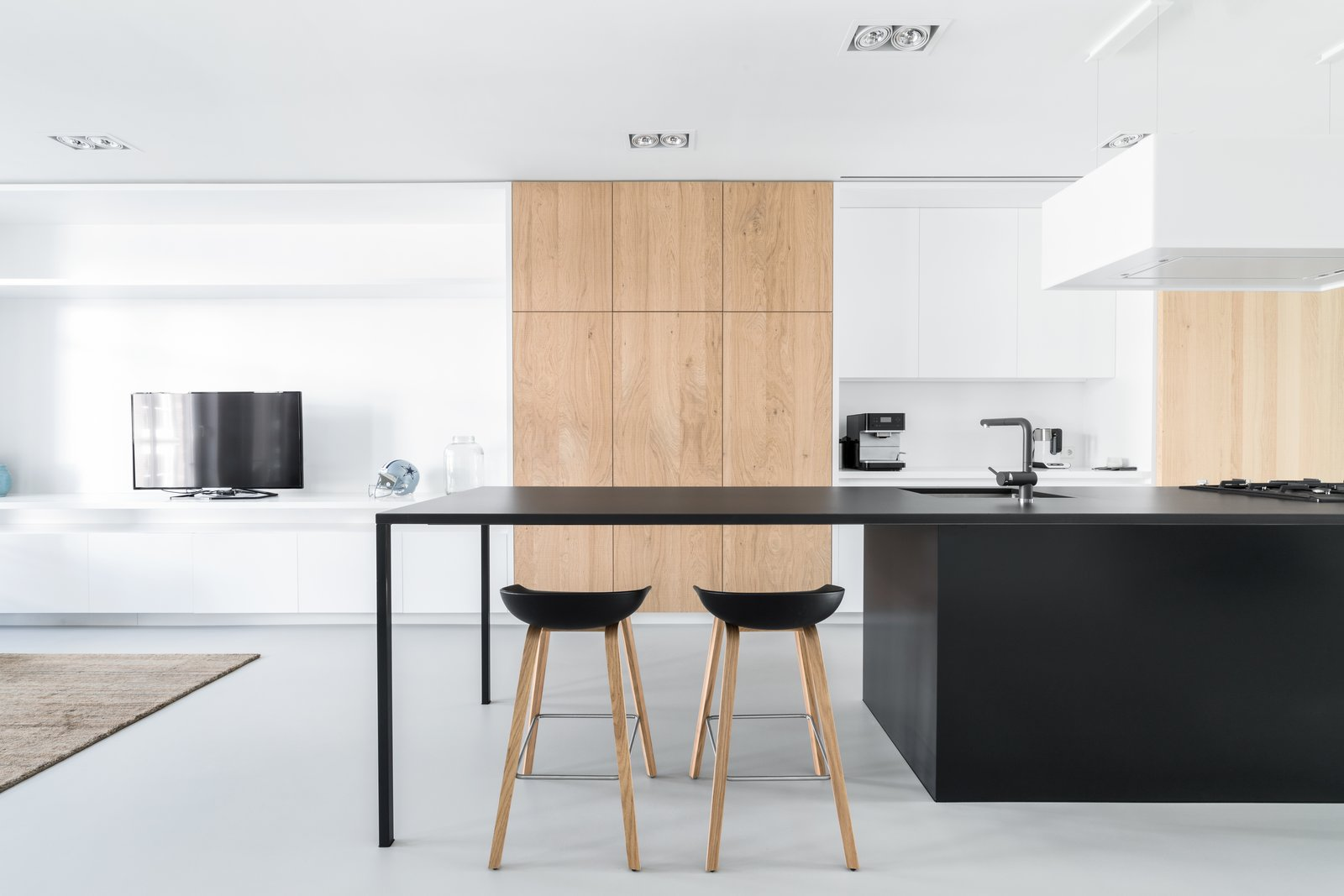 Kitchen, Wood Cabinet, White Cabinet, Ceiling Lighting, and Undermount Sink  Photo 5 of 10 in A Cramped Amsterdam Apartment Is Transformed Into an Airy Loft