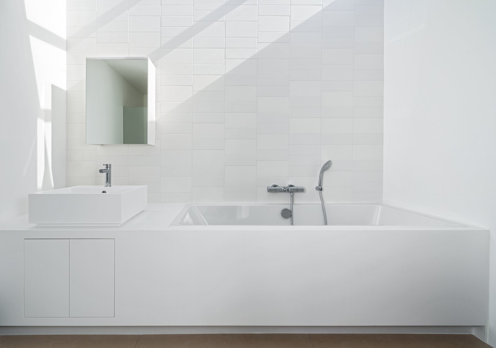 Bath Room, Soaking Tub, Ceramic Tile Wall, and Vessel Sink  Photo 10 of 10 in A Cramped Amsterdam Apartment Is Transformed Into an Airy Loft