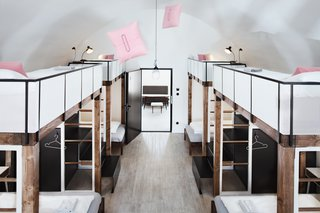 A Stylish Hostel in a Historic Czech Fortress Starts at $16 a Night - Photo 5 of 19 - The biggest dorm room sleeps 10, with four up top and six below. The mezzanine sleeping area maintains the cool factor with perforated guards.