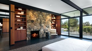 Built-in bookshelves frame each side of the stone fireplace.