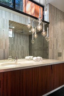 Suspended pendants create a sculptural interest in the bath.