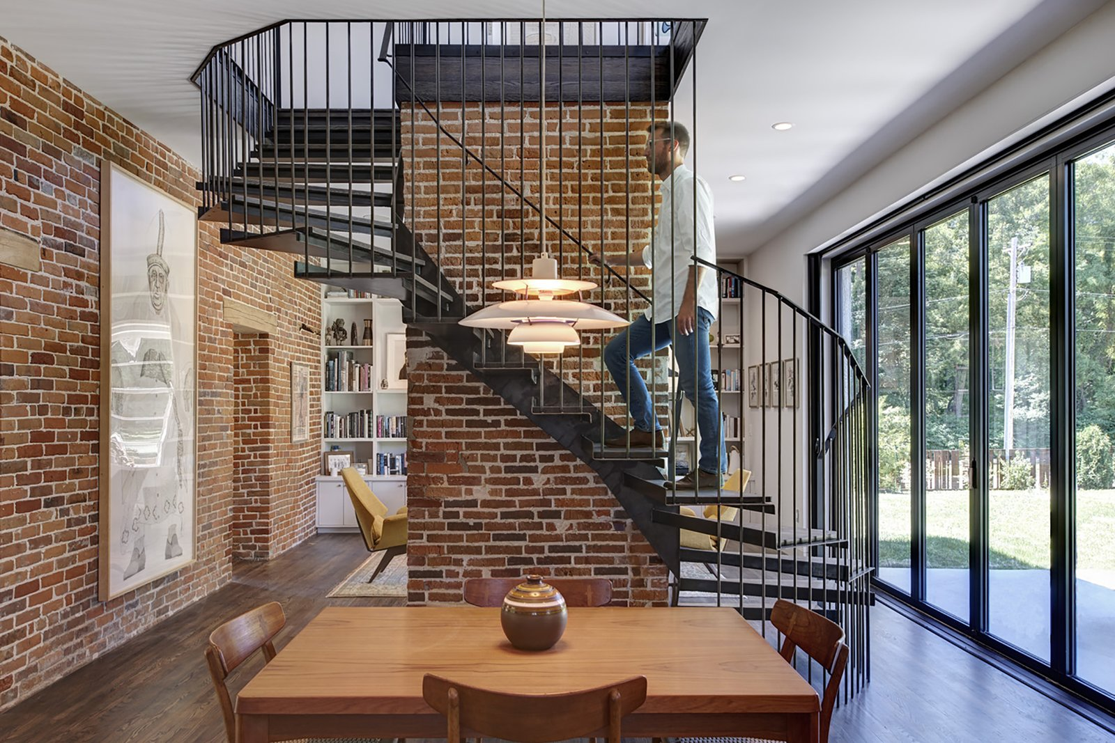 Staircase, Metal Tread, and Metal Railing  Photo 7 of 13 in An 1850s Farmhouse in Iowa City Gets a Modern Makeover