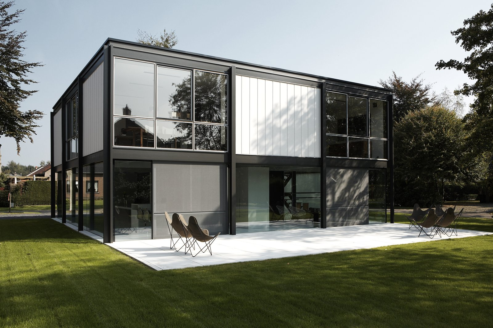 Outdoor, Large Patio, Porch, Deck, Grass, and Trees  Photos from A Fantastic Renovation in Belgium Rescues a Bauhaus-Inspired Home