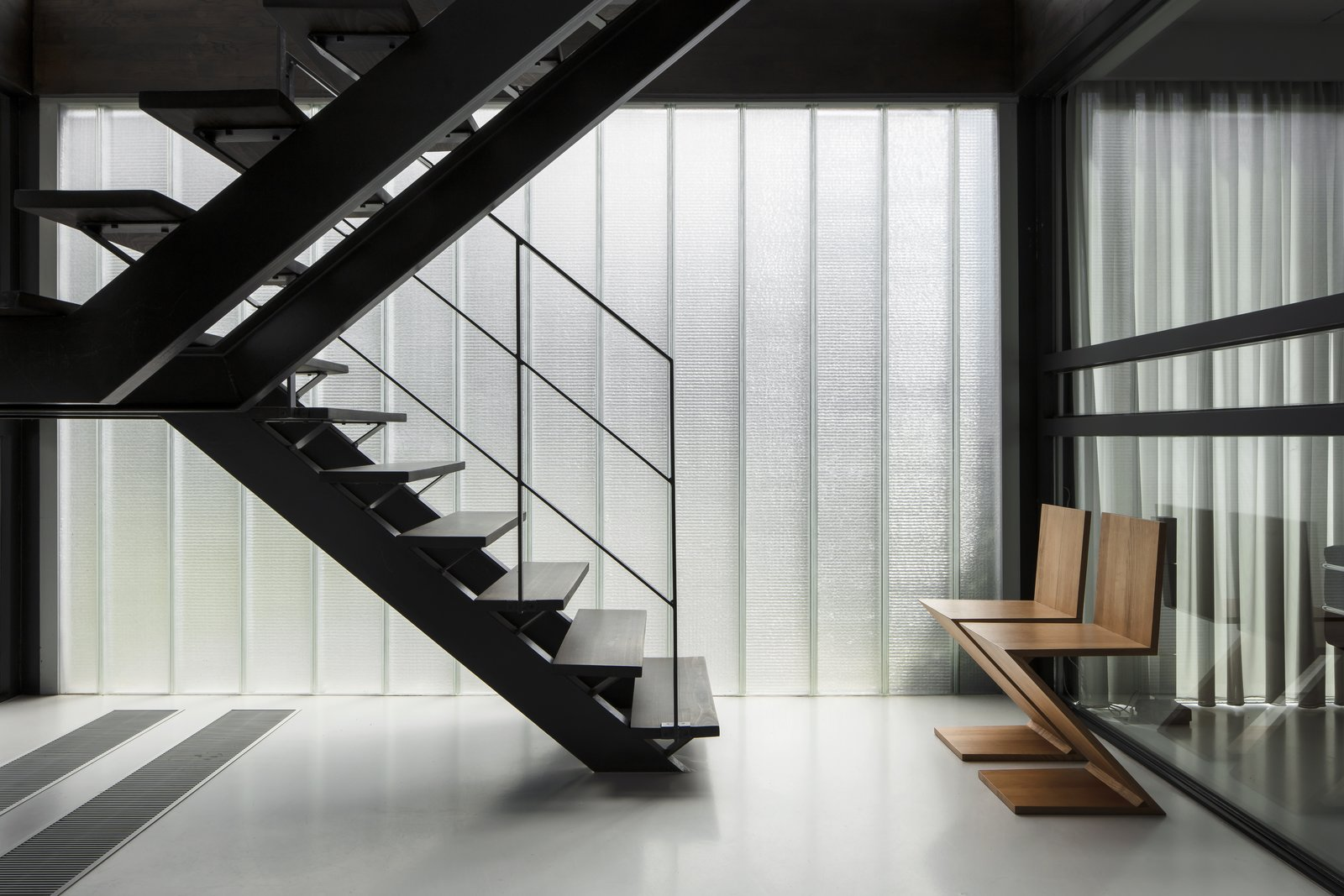 Staircase, Metal Tread, and Metal Railing  Photos from A Fantastic Renovation in Belgium Rescues a Bauhaus-Inspired Home