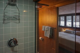 You Can Now Rent Frank Lloyd Wright's Gloriously Restored Eppstein House - Photo 12 of 13 - Unsold tiles from the 1950s were sourced from Battle Creek Tiles & Mosaic.  The vintage tiles maintain the original character of the home in the renovated baths.
