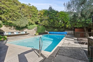 A solar heated pool is one of the many modern amenities that add to the iconic estate.