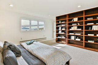 Built-in bookshelves frame the master bedroom.
