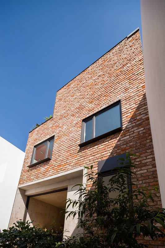 Exterior, House Building Type, and Brick Siding Material  Photo 8 of 10 in A Sculptural Wooden Staircase Steals the Show in This Mexico City Abode