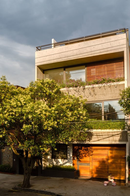Exterior, House Building Type, Concrete Siding Material, and Flat RoofLine  Photo 9 of 10 in A Sculptural Wooden Staircase Steals the Show in This Mexico City Abode