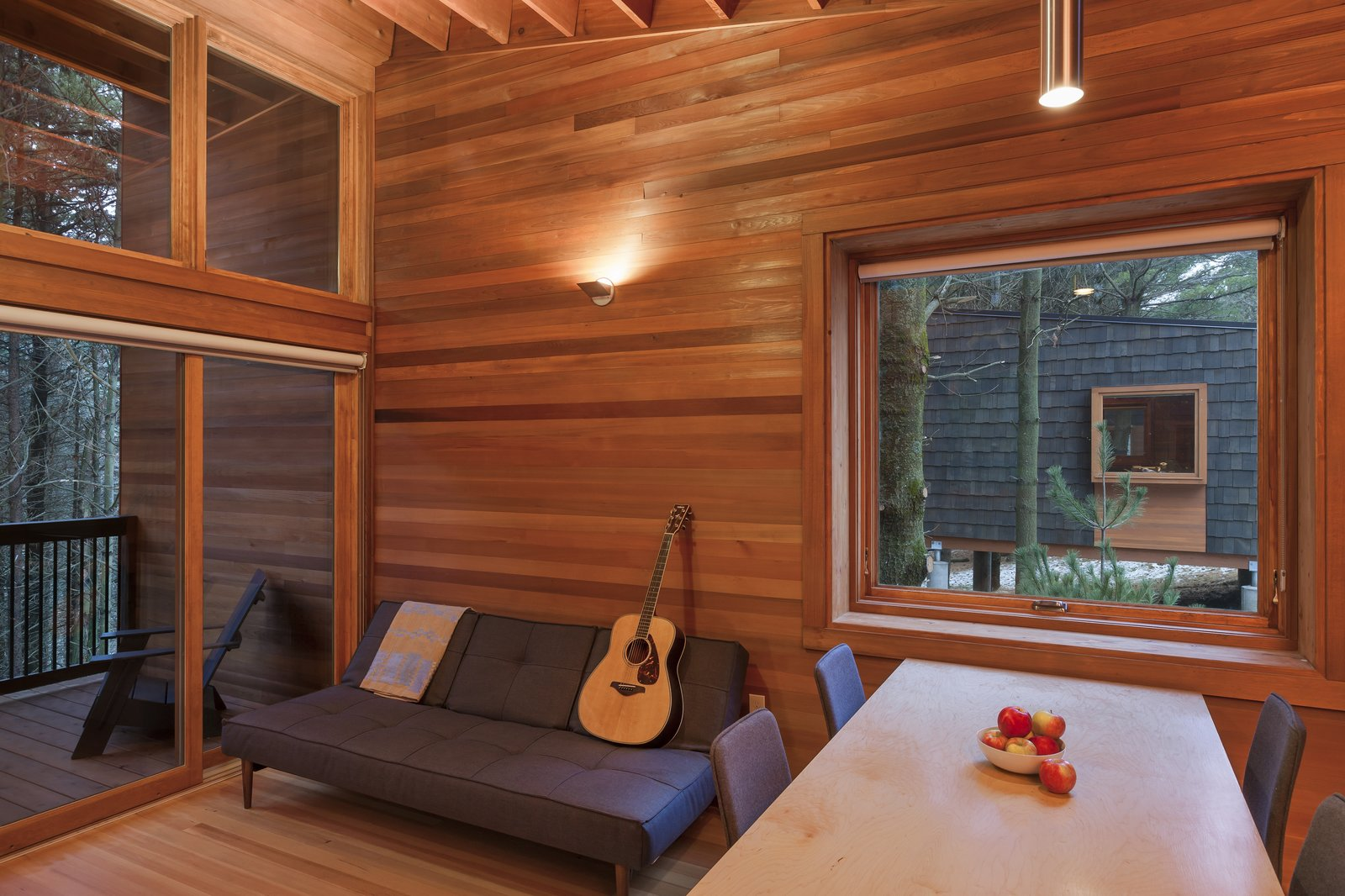 Dining Room, Chair, Pendant Lighting, Medium Hardwood Floor, Table, and Wall Lighting  Photo 8 of 8 in Camp in Style at This Trio of Cedar-Clad Cabins in Minnesota