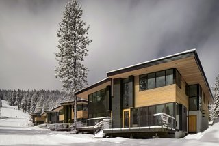 Western red cedar siding wraps the exterior of the townhomes as they step down the ski slope. Anderson E-windows frame views of the mountainside.