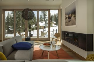 A Town & Country fireplace anchors the living room, providing a warm space to enjoy the views of the outdoors.