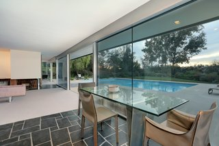 Richard Neutra's Stunning Loring House Is Listed For $5.6M - Photo 3 of 10 - Mario Bellini dining chairs surround the 1980s dining table, which was custom-designed for the owner's previous residence.