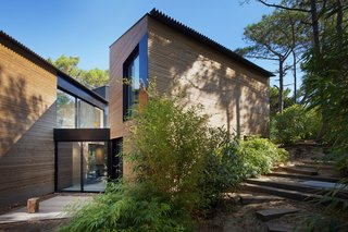 The configuration of the home allows the structure to create minimal impact on the surrounding topography.