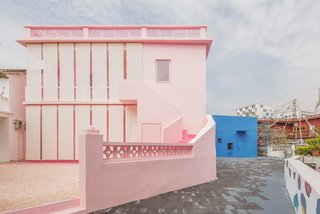 These Pink and Blue Homes Use Gender as a Metaphor For Urban Revitalization - Photo 9 of 17 - Pink rock salt covers the exterior patio.