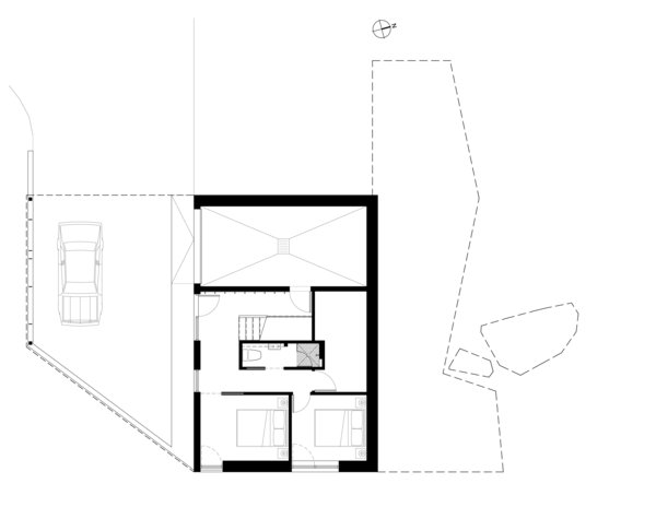 A look at the lower-level floor plan, including the main entry, two bedrooms, and a full bath.