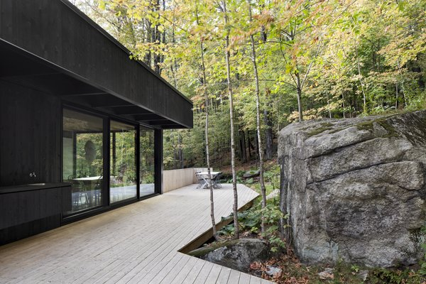 The exterior deck gracefully meanders its way around the rock formations.