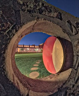"Deeply influenced by Asian culture, art, and design, Wright reflected some of that influence into the design of Taliesin West.  Here, the ""Moon Gate,"" a circular opening, displays a hint of the Eastern influence."