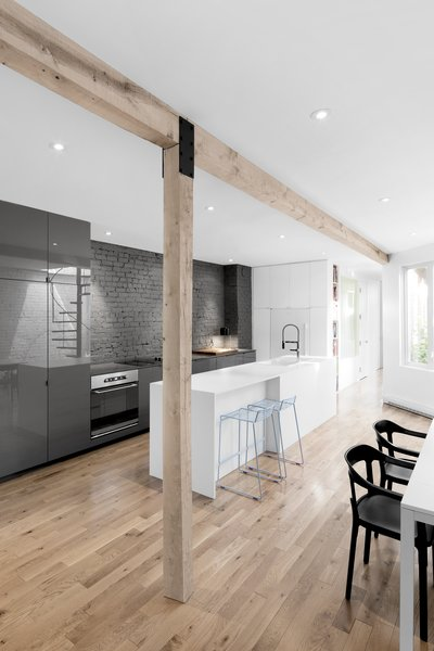 The original load bearing wall was replaced with a wood beam and vertical supports, creating a more open floor plan.