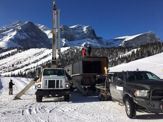 This Prefab Shipping Container Bar Can Pop Up Just About Anywhere - Photo 4 of 9 - With minimal labor and vehicular transportation, the Honomobar was transported up the snow covered hills to Fortress Mountain in the Canadian Rockies.