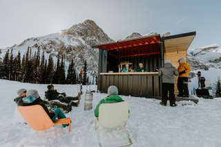 This Prefab Shipping Container Bar Can Pop Up Just About Anywhere - Photo 8 of 9 - Outdoor enthusiasts gather at the bar for a quick drink.