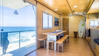 Large sliding glass doors draw in plenty of daylight while providing beachfront access.