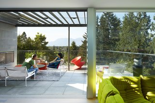 The main living space extends onto a trellis-covered outdoor terrace.  Complete with a fireplace and mountain views, it is an idyllic space to reconnect with nature.