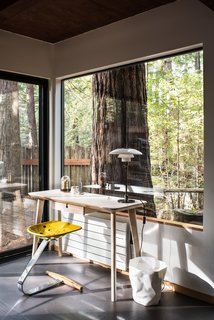 Large windows and sliding glass doors provide a direct connection to the outdoors.