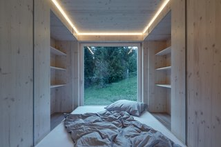 On one end of the home lies a sleeping area with built-in storage.