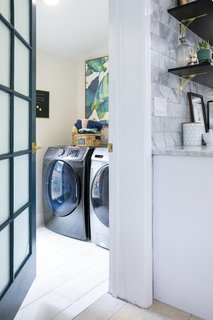 The enlarged laundry room provides just enough space for the growing family.