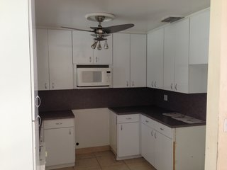 The existing kitchen was cramped, dark, and outdated.  The '80s finishes and small floor plate needed to be updated in order for the space to be functional.