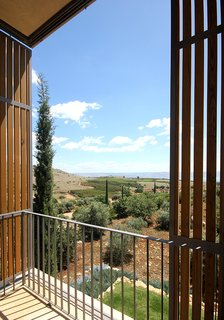 Private balconies provide unobstructed views of the surrounding landscape from each bedroom.
