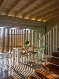 The wood shutters provide ever-changing patterns of light.  As the sun changes throughout the day, the light falls in diverse patterns through the light-filtering screens.