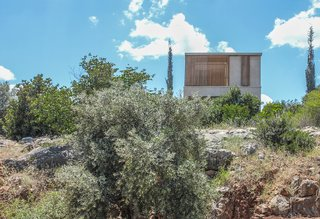The residence appears as a simple box perched at the edge of the rocks.  Simple in form, the intricate thoughtfulness to site and character is concealed.
