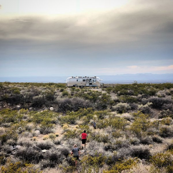 With their renovated airstream trailer, the family can choose where they want to live each week, whether it is the mountains, forests, desert, or by the ocean.