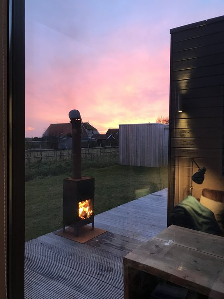 Exterior wood-burning fireplaces draw original camping elements into the luxury of an enclosed, private cabin.