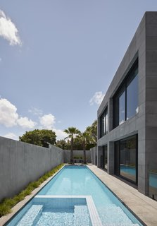 The side yard is filled with a long, narrow built-in swimming pool. It is the perfect environment to enjoy the Australian sunshine.