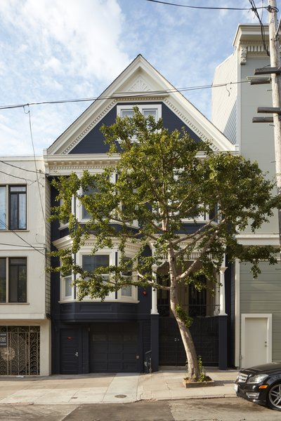 This dark-blue 1907 home appears to be typical of the Victorian character that was evident in early 1900's residential architecture. Unbeknownst from the outside are the bright, light-filled interiors and modern interventions.