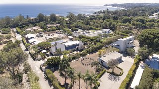 An aerial view of the home and dramatic ocean vistas in Malibu.