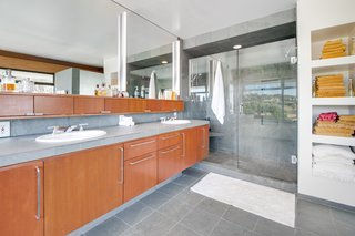 Not only does the master bath include a large soaking tub, it also features a gracious vanity and a walk-in tile shower.
