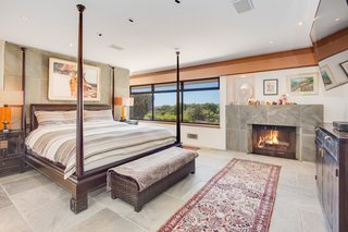 The master bedroom comes complete with its own fireplace and astounding views.