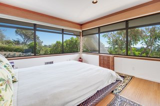 Large windows in the bedrooms create the feeling of sleeping in the trees.